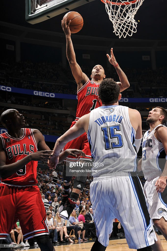 <a gi-track='captionPersonalityLinkClicked' href=/galleries/search?phrase=Derrick+Rose&family=editorial&specificpeople=4212732 ng-click='$event.stopPropagation()'>Derrick Rose</a> #1 of the Chicago Bulls shoots over <a gi-track='captionPersonalityLinkClicked' href=/galleries/search?phrase=Hedo+Turkoglu&family=editorial&specificpeople=201639 ng-click='$event.stopPropagation()'>Hedo Turkoglu</a> #15 and Ryan Anderson #33 of the Orlando Magic on April 10, 2011 at the Amway Center in Orlando, Florida.