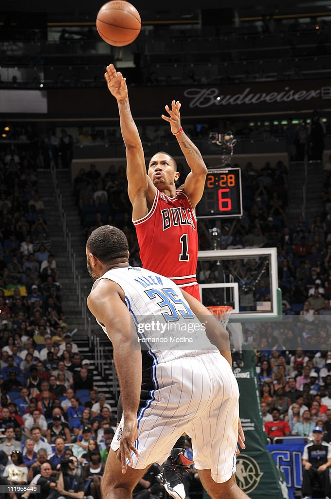 <a gi-track='captionPersonalityLinkClicked' href=/galleries/search?phrase=Derrick+Rose&family=editorial&specificpeople=4212732 ng-click='$event.stopPropagation()'>Derrick Rose</a> #1 of the Chicago Bulls shoots over <a gi-track='captionPersonalityLinkClicked' href=/galleries/search?phrase=Malik+Allen&family=editorial&specificpeople=203257 ng-click='$event.stopPropagation()'>Malik Allen</a> #35 of the Orlando Magic on April 10, 2011 at the Amway Center in Orlando, Florida.