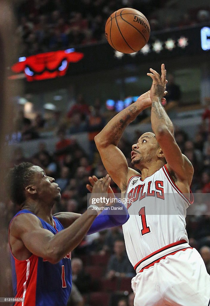 Derrick Rose #1 of the Chicago Bulls shoots over Reggie Jackson #1 of the Detroit Pistons at the United Center on December 18, 2015 in Chicago, Illinois. The Pistons defeated the Bulls 147-144 in quadruple overtime.
