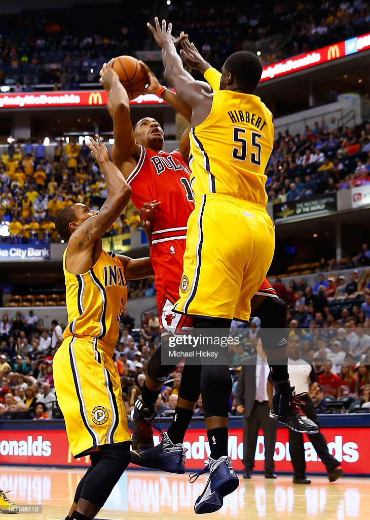 <a gi-track='captionPersonalityLinkClicked' href=/galleries/search?phrase=Derrick+Rose&family=editorial&specificpeople=4212732 ng-click='$event.stopPropagation()'>Derrick Rose</a> #1 of the Chicago Bulls shoots the ball against <a gi-track='captionPersonalityLinkClicked' href=/galleries/search?phrase=Roy+Hibbert&family=editorial&specificpeople=725128 ng-click='$event.stopPropagation()'>Roy Hibbert</a> #55 of the Indiana Pacers on October 5, 2013 at Bankers Life Fieldhouse in Indianapolis, Indiana. Chicago defeated Indiana 82-76.