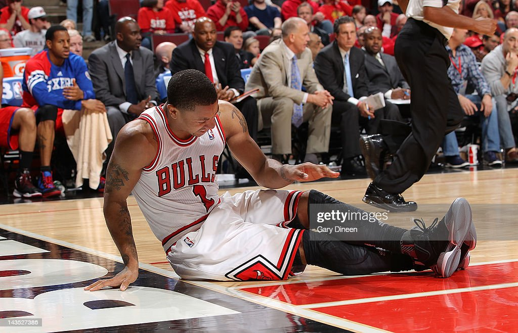 Derrick Rose #1 of the Chicago Bulls sits on the floor after injuring his knee against the Philadelphia 76ers in Game One of the Eastern Conference Quarterfinals during the 2012 NBA Playoffs on April 28, 2012 at the United Center in Chicago, Illinois.