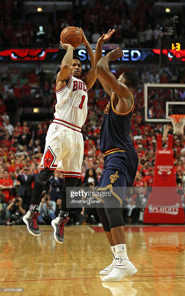 Derrick Rose #1 of the Chicago Bulls takes the game-winning three-point shot over Tristan Thompson #13 of the Cleveland Cavaliers in Game Three of the Eastern Conference Semifinals of the 2015 NBA Playoffs at the United Center on May 8, 2015 in Chicago, Illinois. The Bulls defeated the Cavaliers 99-96.