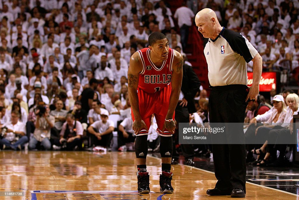 Derrick Rose #1 of the Chicago Bulls talks with referee Joey Crawford against the Miami Heat in Game Four of the Eastern Conference Finals during the 2011 NBA Playoffs on May 24, 2011 at American Airlines Arena in Miami, Florida.