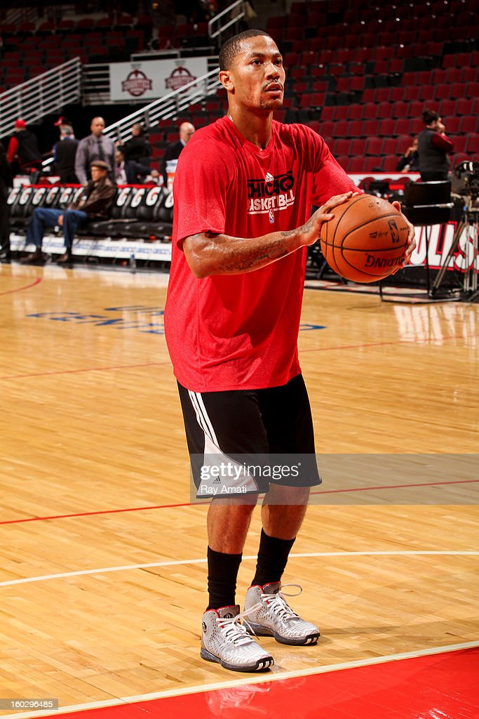 Derrick Rose #1 of the Chicago Bulls warms up before a game against the Charlotte Bobcats on January 28, 2013 at the United Center in Chicago, Illinois. Rose has been sidelined with a torn ACL injury since last April.