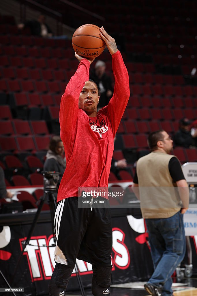 <a gi-track='captionPersonalityLinkClicked' href=/galleries/search?phrase=Derrick+Rose&family=editorial&specificpeople=4212732 ng-click='$event.stopPropagation()'>Derrick Rose</a> #1 of the Chicago Bulls warms up before the game against the Utah Jazz on March 08, 2013 at the United Center in Chicago, Illinois.
