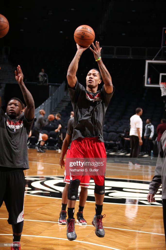 <a gi-track='captionPersonalityLinkClicked' href=/galleries/search?phrase=Derrick+Rose&family=editorial&specificpeople=4212732 ng-click='$event.stopPropagation()'>Derrick Rose</a> #1 of the Chicago Bulls warms up before the game between the Brooklyn Nets and the Chicago Bulls in Game One of the Eastern Conference Quarterfinals during the 2013 NBA Playoffs on April 20 at the Barclays Center in the Brooklyn borough of New York City.