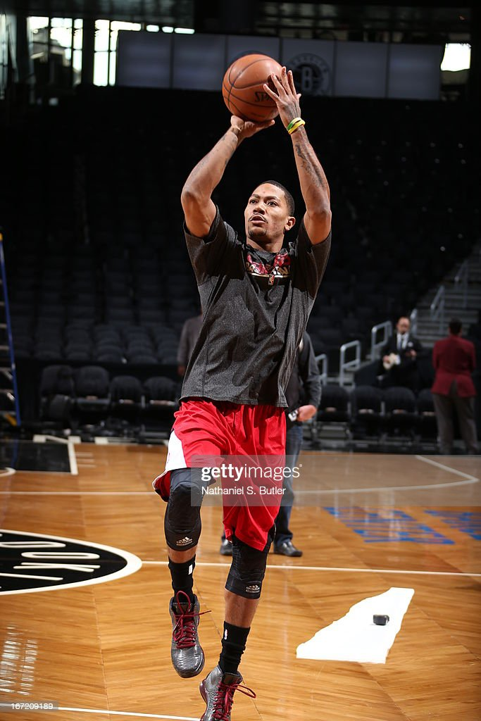 Derrick Rose #1 of the Chicago Bulls warms up before the game between the Brooklyn Nets and the Chicago Bulls in Game One of the Eastern Conference Quarterfinals during the 2013 NBA Playoffs on April 20 at the Barclays Center in the Brooklyn borough of New York City.