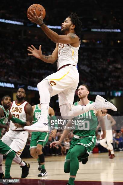 Derrick Rose of the Cleveland Cavaliers drive to the basket past Gordon Hayward of the Boston Celtics during the first half at Quicken Loans Arena on...