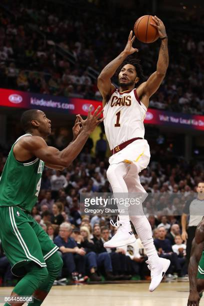 Derrick Rose of the Cleveland Cavaliers drives to the basket past Al Horford of the Boston Celtics during the first half at Quicken Loans Arena on...