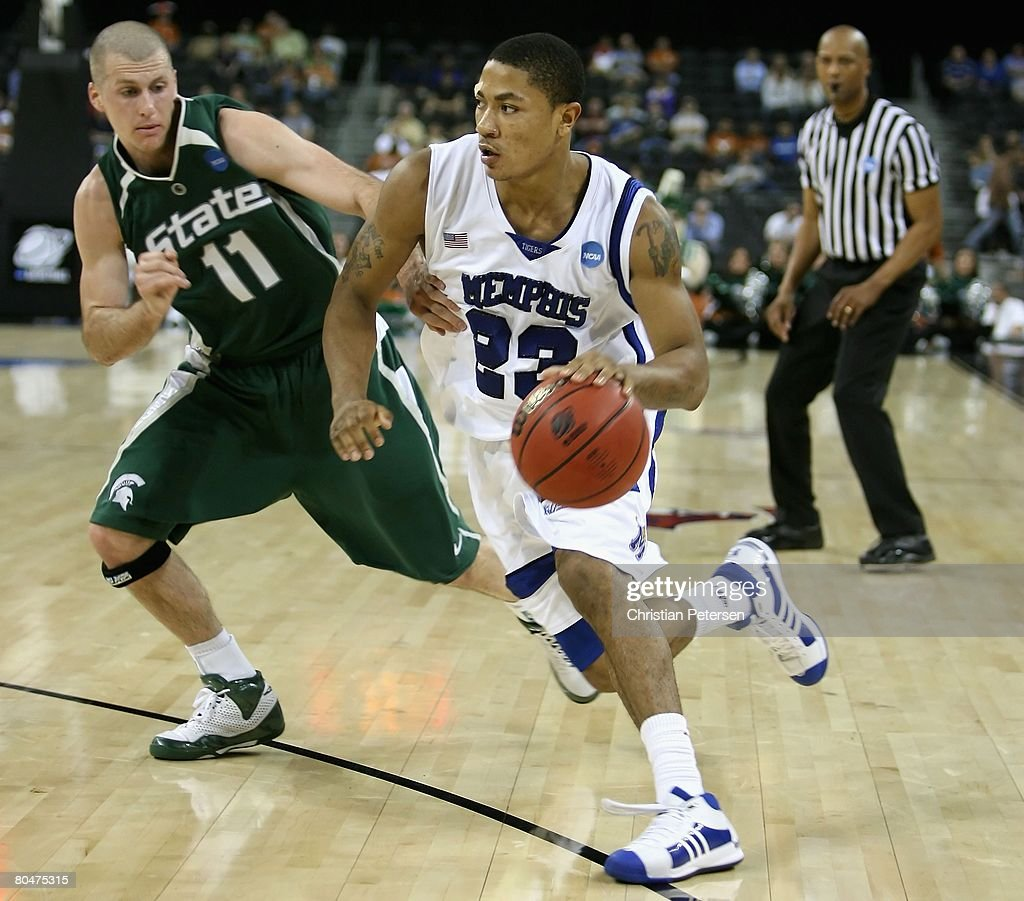 Derrick Rose of the Memphis Tigers drives the ball past Drew Neitzel of the Michigan St Spartans during the third round game of the South Regional as...
