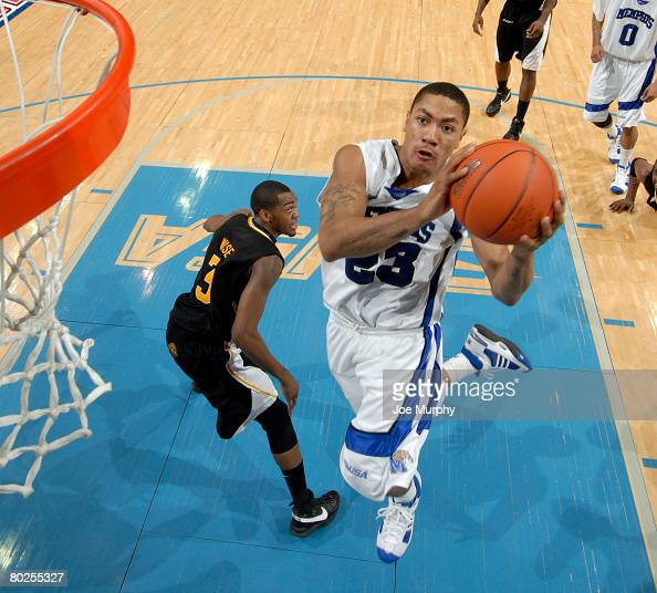 Derrick Rose of the Memphis Tigers drives to the basket for a layup past Jeremy Wise of the Southern Miss Golden Eagles during the semifinals of the...