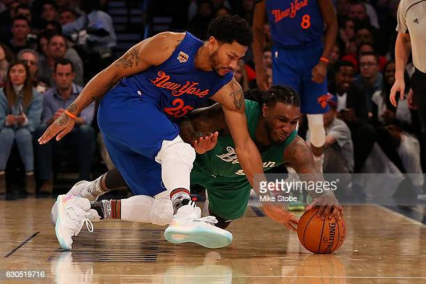 Derrick Rose of the New York Knicks and Jae Crowder of the Boston Celtics battle for the ball at Madison Square Garden on December 25 2016 in New...