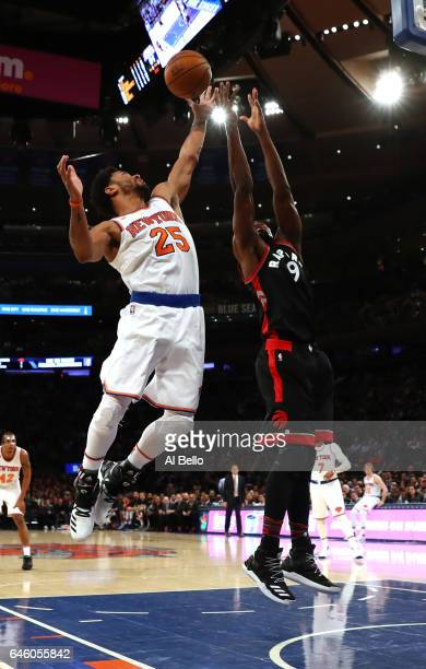 Derrick Rose of the New York Knicks and Serge Ibaka of the Toronto Raptors battle for the ball during their game at Madison Square Garden on February...