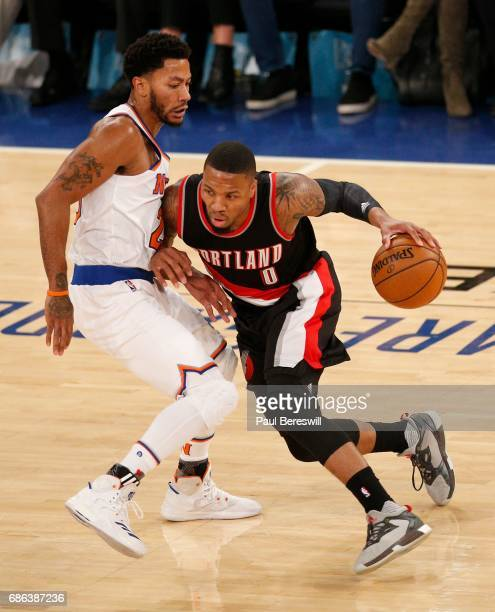 Derrick Rose of the New York Knicks defends against Damian Lillard of the Portland Trail Blazers in an NBA basketball game on November 22 2016 at...