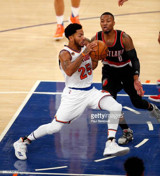 Derrick Rose of the New York Knicks drives on Damian Lillard of the Portland Trail Blazers in an NBA basketball game on November 22 2016 at Madison...