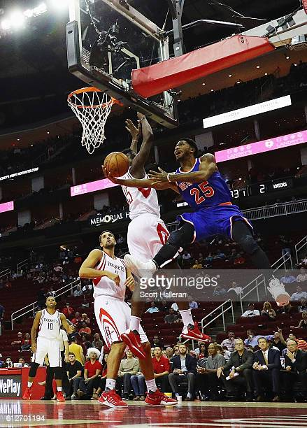 Derrick Rose of the New York Knicks drives with the basketball against Clint Capela of the Houston Rockets during their game at the Toyota Center on...