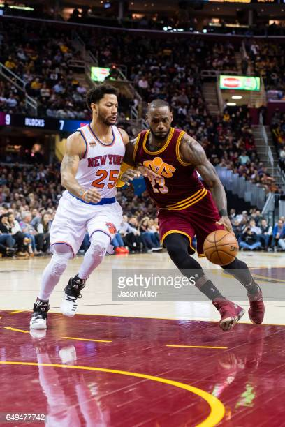 Derrick Rose of the New York Knicks puts pressure on LeBron James of the Cleveland Cavaliers during the second half at Quicken Loans Arena on...