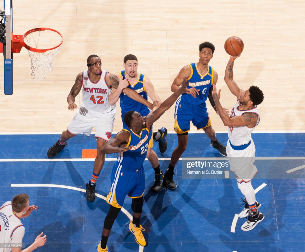 Derrick Rose #25 of the New York Knicks shoots the ball against Draymond Green #23 of the Golden State Warriors on March 5, 2017 at Madison Square Garden in New York City, New York.