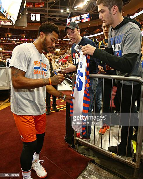 Derrick Rose of the New York Knicks signs autographs before the game against the Cleveland Cavaliers on October 25 2016 at Quicken Loans Arena in...
