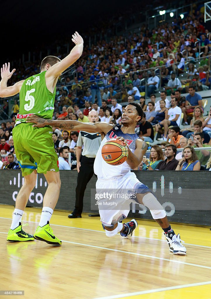 <a gi-track='captionPersonalityLinkClicked' href=/galleries/search?phrase=Derrick+Rose&family=editorial&specificpeople=4212732 ng-click='$event.stopPropagation()'>Derrick Rose</a> #6 of the USA Basketball Men's National Team handles the ball against the Slovenia Basketball Men's National Team on August 26, 2014 at Gran Canaria Arena in Las Palmas, Gran Canaria, Spain.