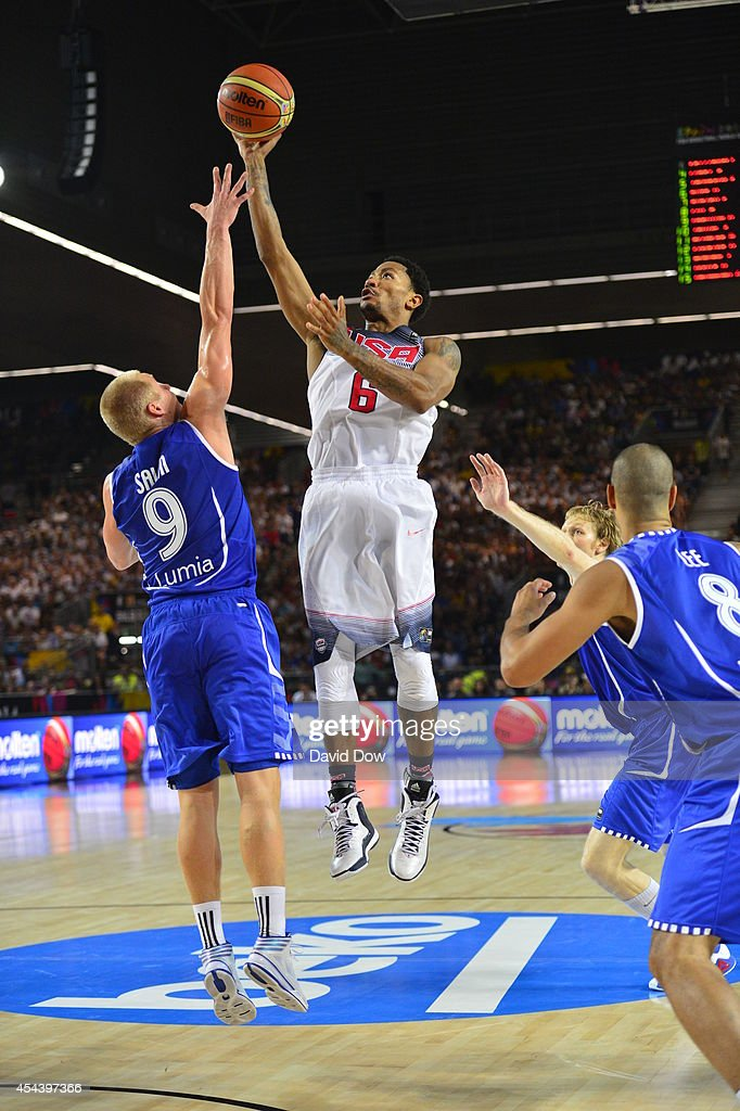 <a gi-track='captionPersonalityLinkClicked' href=/galleries/search?phrase=Derrick+Rose&family=editorial&specificpeople=4212732 ng-click='$event.stopPropagation()'>Derrick Rose</a> #6 of the USA Basketball Men's National Team shoots the basketball against Sasu Salin #9 of the Finland Nation Basketball Team during the FIBA 2014 World Cup Tournament at the Bilbao Exhibition Center on August 30, 2014 in Bilbao, Spain.