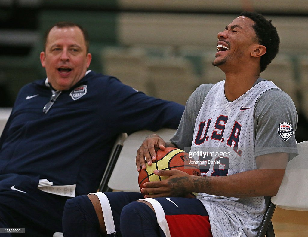Derrick Rose, wearing #28, laughs at a story told by assistant USA coach and his head coach of the Chicago Bulls, Tom Thibodeau, during a USA basketball training session at Quest MultiSport Complex on August 15, 2014 in Chicago, Illinois.