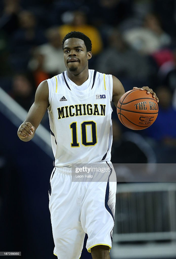 Derrick Walton Jr. #10 of the Michigan Wolverines dribbles the ball during the second half of the game against Wayne State University at Crisler Center on November 4, 2013 in Ann Arbor, Michigan. Michigan defeated Wayne State 79-60.