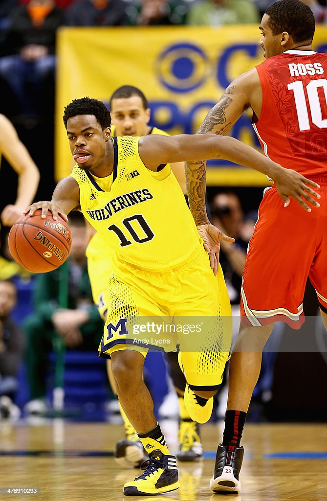 Derrick Walton Jr. #10 of the Michigan Wolverines drives the ball past LaQuinton Ross #10 of the Ohio State Buckeyes during the first half of the Big Ten Basketball Tournament Semifinal game at Bankers Life Fieldhouse on March 15, 2014 in Indianapolis, Indiana.