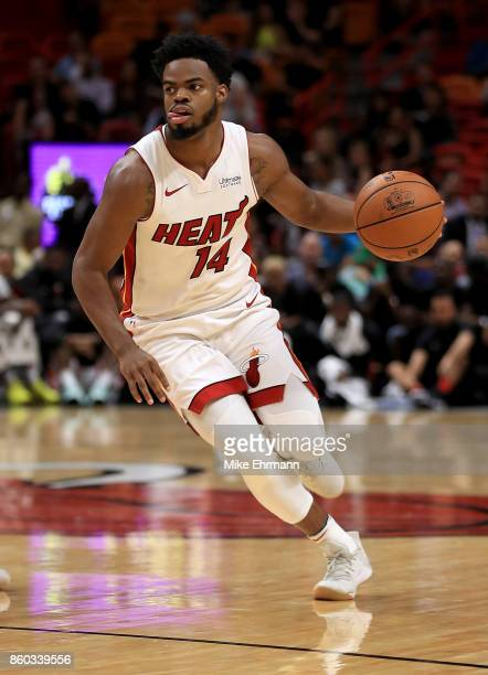 Derrick Walton Jr #14 of the Miami Heat drives during a preseason game against the Washington Wizards at American Airlines Arena on October 11 2017...