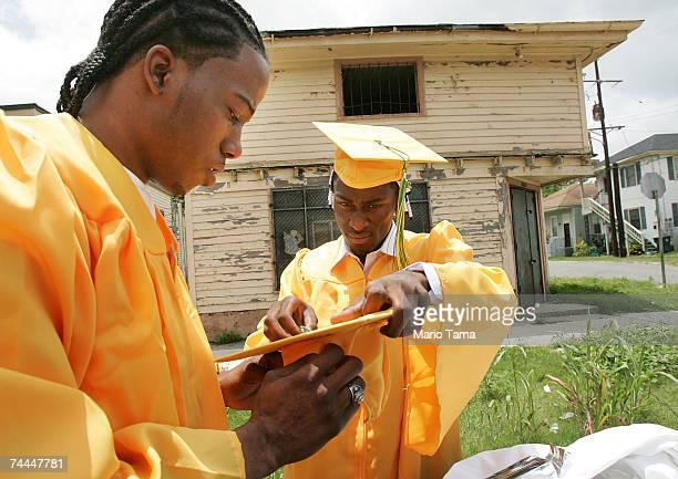 Derrick Warren and Kevin Green students from John McDonogh Senior High School's first graduating class since Hurricane Katrina prepare their caps and...