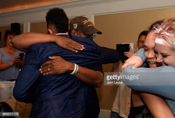 Derrick White gets a hug from his dad Rich after finding out the San Antonio Spurs had selected him 29th in the first round of the NBA Draft on June...