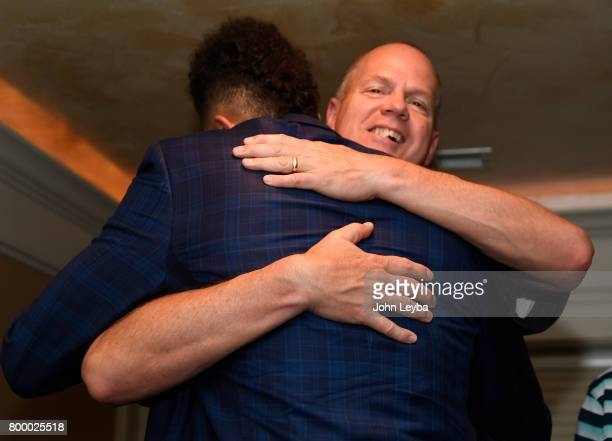 Derrick White gets a hug from Tad Boyle men's basketball coach at the University of Colorado after finding out the San Antonio Spurs had selected him...