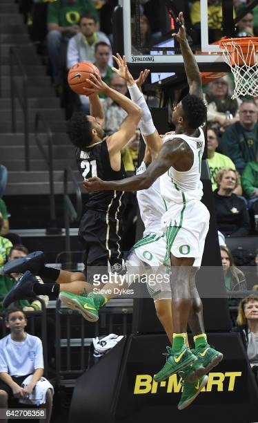 Derrick White of the Colorado Buffaloes drives to the basket on Dillon Brooks and Jordan Bell of the Oregon Ducks during the second half of the game...