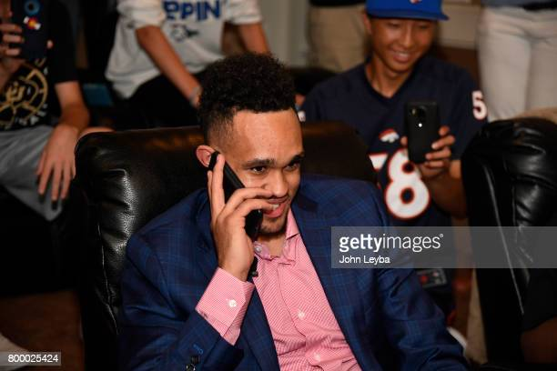Derrick White on the phone with the San Antonio Spurs who would select him 29th in the first round of the NBA Draft on June 22 2017 in Parker Colorado