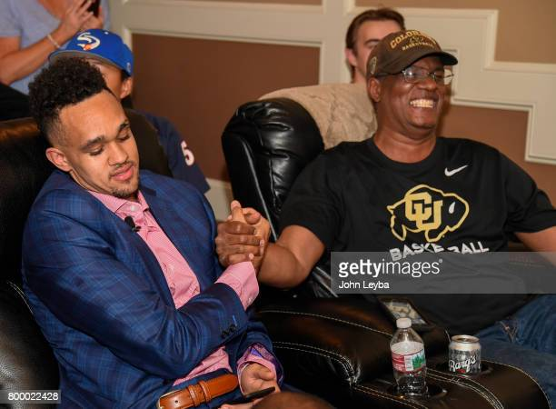Derrick White shakes hands with his dad Rich after finding out the San Antonio Spurs had selected him 29th in the first round of the NBA Draft on...