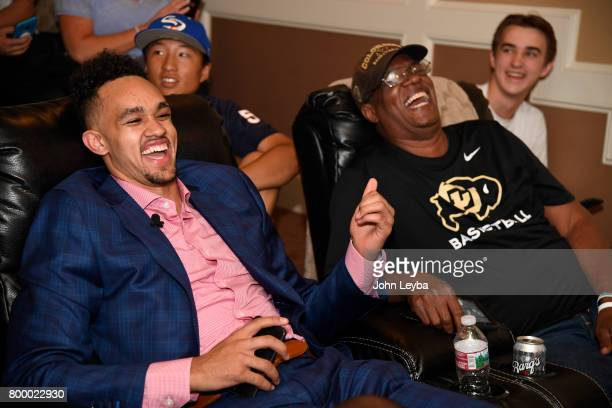 Derrick White shakes shares a laugh with his dad Rich after finding out the San Antonio Spurs had selected him 29th in the first round of the NBA...