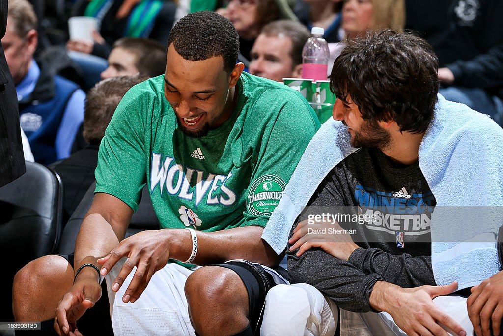 Derrick Williams #7 and Ricky Rubio #9 of the Minnesota Timberwolves share a laugh on the bench during a game against the New Orleans Hornets on March 17, 2013 at Target Center in Minneapolis, Minnesota.