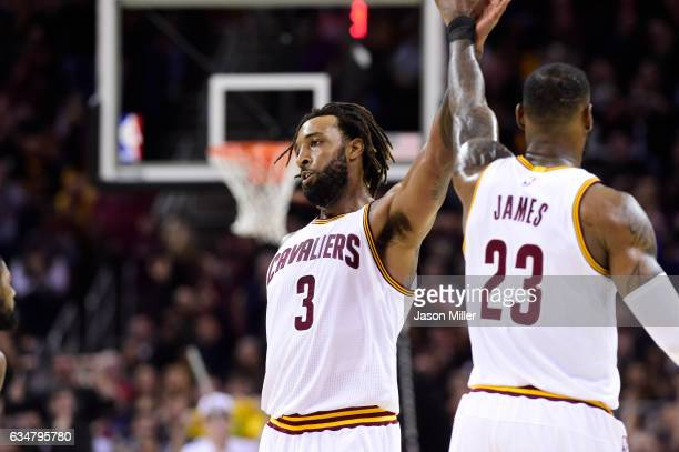 Derrick Williams celebrates with LeBron James of the Cleveland Cavaliers during the first half against the Denver Nuggets at Quicken Loans Arena on...