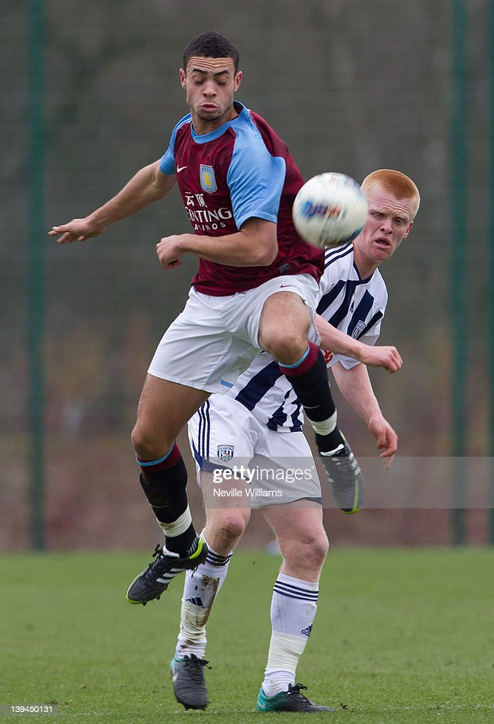 Derrick Williams of Aston Villa is challenged by Liam O'Neil of West Bromwich Albion during the Barclays Premier Reserve League match between Aston Villa Reserves and West Bromwich Albion Reserves at the club's training ground at Bodymoor Heath on February 21, 2012 in Birmingham, England.