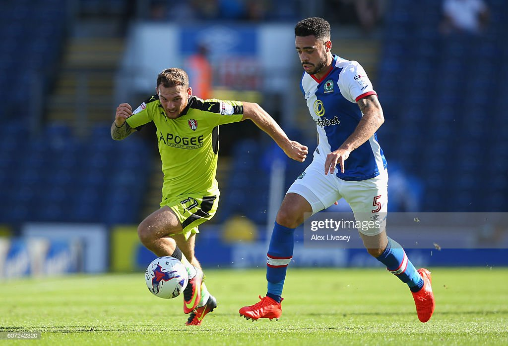 Derrick Williams of Blackburn Rovers and Jon Taylor of Rotherham United battle for the ball during the Sky Bet Championship match between Blackburn Rovers and Rotherham United at Ewood Park on September 17, 2016 in Blackburn, England.