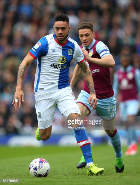 Derrick Williams of Blackburn Rovers goes past James Chester of Aston Villa during the Sky Bet Championship match between Blackburn Rovers and Aston...