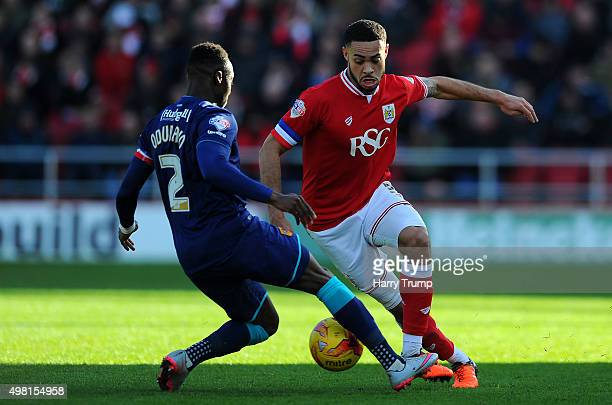 Derrick Williams of Bristol City is tackled by Moses Odubajo of Hull City during the Sky Bet Championship match between Bristol City and Hull City at...