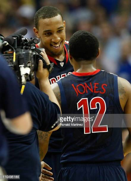 Derrick Williams of the Arizona Wildcats celebrates with teammate Lamont Jones after defeating the Texas Longhorns 7069 in the third round of the...