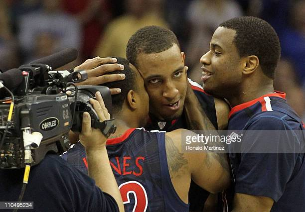 Derrick Williams of the Arizona Wildcats celebrates with teammates Kevin Parrom and Lamont Jones after defeating the Texas Longhorns 7069 in the...