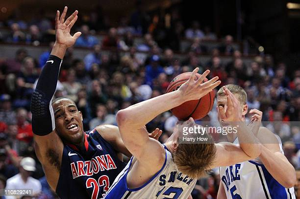 Derrick Williams of the Arizona Wildcats draws contact against Kyle Singler of the Duke Blue Devils during the west regional semifinal of the 2011...