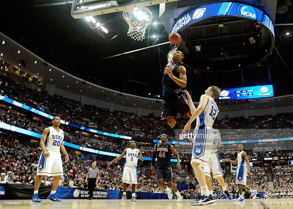 Derrick Williams #23 of the Arizona Wildcats dunks the over <a gi-track='captionPersonalityLinkClicked' href=/galleries/search?phrase=Kyle+Singler&family=editorial&specificpeople=4216029 ng-click='$event.stopPropagation()'>Kyle Singler</a> #12 of the Duke Blue Devils during the west regional semifinal of the 2011 NCAA men's basketball tournament at the Honda Center on March 24, 2011 in Anaheim, California.