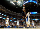 Derrick Williams of the Arizona Wildcats dunks the over Kyle Singler of the Duke Blue Devils during the west regional semifinal of the 2011 NCAA...