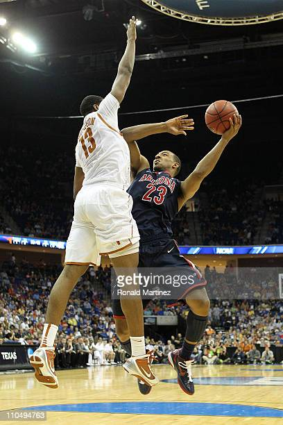 Derrick Williams of the Arizona Wildcats goes up for a shot against Tristan Thompson of the Texas Longhorns during the third round of the 2011 NCAA...