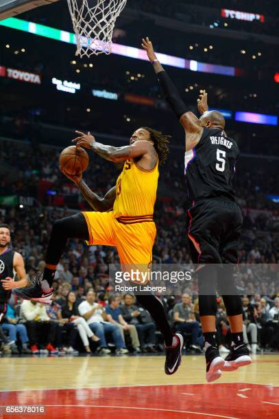 Derrick Williams of the Cleveland Cavaliers attempts a lay up against Marreese Speights of the Los Angeles Clippers on March 18 2017 at STAPLES...