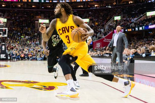 Derrick Williams of the Cleveland Cavaliers drives past Jason Terry of the Milwaukee Bucks during the second half at Quicken Loans Arena on February...